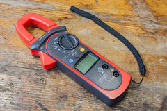Clamp multimeter with accessories on a table in a workshop Royalty Free Stock Photography