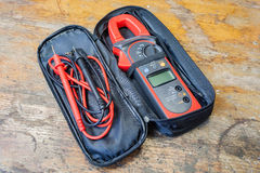 Clamp multimeter with accessories on a table in a workshop Royalty Free Stock Image