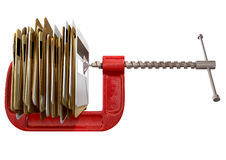 Clamped Credit Card Crunch. A concept pile of credit cards being squeezed by a red clamp on an isolated background Stock Images
