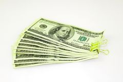 Clamped dollar bills Royalty Free Stock Photo
