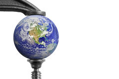 Clamped Earth. Image of Earth squeezed in a clamp Stock Images
