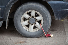 clamped front wheel of illegally parked car Stock Photos