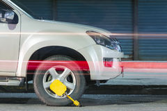 Clamped front wheel. Wheel locks, concept of car. Royalty Free Stock Photos