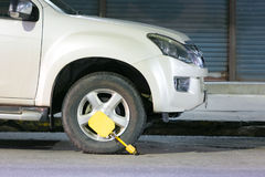 Clamped front wheel. Wheel locks, concept of car. Stock Images