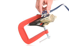 Clamped wallet examined with stethoscope Royalty Free Stock Photos