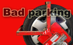 Clamped wheel. Clamped car in the restricted parking zone after bad parking Stock Photo