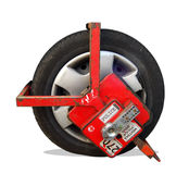 Clamped wheel. Clamped car in the restricted parking zone after bad parking Stock Photography
