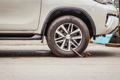 Clamped Wheel, Car Locked by Police for Prohibit Park. Royalty Free Stock Photography
