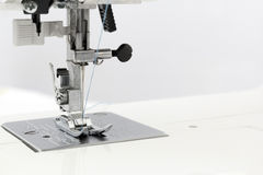Clamping pad with a sewing-machine needle Stock Image