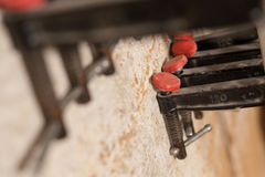 Clamps in a carpenter workshop Stock Image