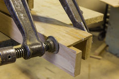 Clamps holding workpiece gluing Stock Images