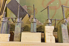 Clamps holding workpiece gluing Royalty Free Stock Photos
