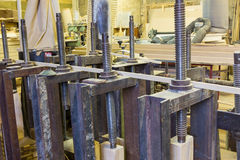 Clamps holding workpiece gluing Stock Image