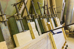 Clamps holding workpiece gluing Stock Photo