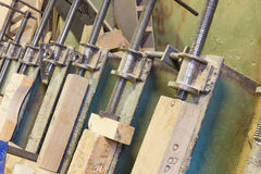 Clamps holding workpiece gluing Royalty Free Stock Photography