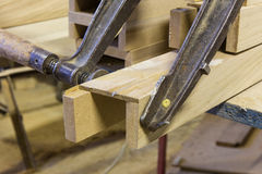Clamps holding workpiece gluing Royalty Free Stock Photo