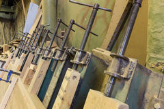 Clamps holding workpiece gluing Stock Photos