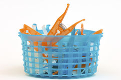 Clamps tend clothes. Blue plastic box containing clothes tend clips Royalty Free Stock Image