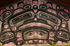 Clan House Carvings. Ketchikan, AK, USA - May 24, 2016: Native American Totems and Clan Houses located at Totem Bight State Historic Site royalty free stock photography