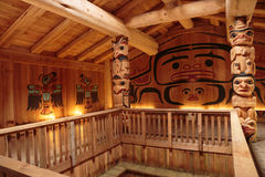 Clan House Interior. Ketchikan, AK, USA - May 24, 2016: Native American Totems and Clan Houses located at Totem Bight State Historic Site stock photo