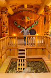 Clan House Interior. Ketchikan, AK, USA - May 24, 2016: Native American Totems and Clan Houses located at Totem Bight State Historic Site stock image