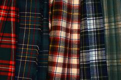 Clan tartan or plaid kilts in assorted colors. For each clan or family, there are often numerous other official or unofficial variations. Tartan Day is a stock image