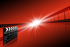 Clap board ant film strip on red background. Clap board and two film strips on red background Royalty Free Stock Photo