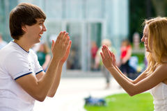 Clap their hands. Girls and boys are facing each other, clap their hands and laughing Stock Photos