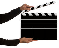 Clapboard. Hands holding clapboard on white background Stock Photo