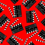 Clapboard background. Opened movie clapboard seamless pattern over red Royalty Free Stock Images