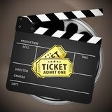 Clapboard and cinema tickets on film reels. 3D illustration.  stock illustration
