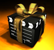 Clapboard & Film. Closed box in format of clapboard tied by film outside Royalty Free Stock Photos