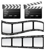 Clapboard and film. On the white background Royalty Free Stock Images