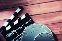 Clapperboard with film tapes stock photo