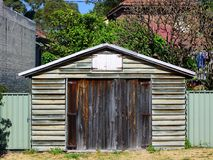 Clapboard Garage. An old clapboard or weatherboard garage or shed, with faded and flaking paint, in a suburban area, Sydney, Australia stock photo