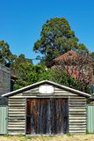 Clapboard Garage. An old clapboard or weatherboard garage or shed, with faded and flaking paint, in a suburban area, Sydney, Australia stock photos