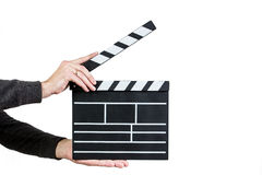 Clapboard. Man ready to clap clapboard on white background Stock Photography