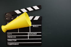 Clapboard and megaphone Royalty Free Stock Image