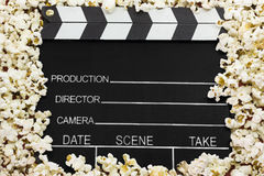 Clapboard with pop corns Stock Photography