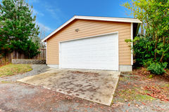 Clapboard siding garage with drive way Royalty Free Stock Photos