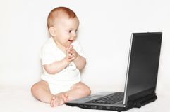 Clapped baby with notebook Stock Image