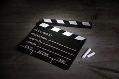 Clapper κινηματογράφων στους εκλεκτής ποιότητας πίνακες Στοκ φωτογραφία με δικαίωμα ελεύθερης χρήσης