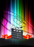 Clapper on Abstract Spectrum Background Stock Photos
