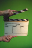 Clapper board. Isolated on green Stock Photo