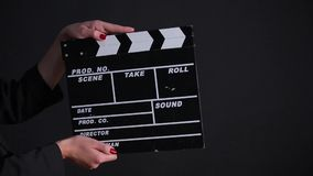 Clapper Board. In action on a gray background stock footage