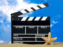 Clapper board on the beach Royalty Free Stock Images