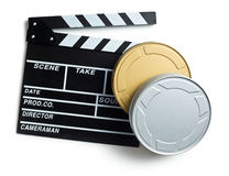 Clapper board with boxes of film reels Stock Photos