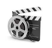 Clapper board with film reel. 3d render of clapper board with film reel isolated on white background Royalty Free Stock Images