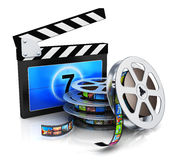 Clapper board and film reel with filmstrip. Cinema, movie, film and video media industry production concept: clapper board, metal film reel with filmstrip with Royalty Free Stock Photo