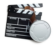 Clapper board with film reel on white background Royalty Free Stock Image